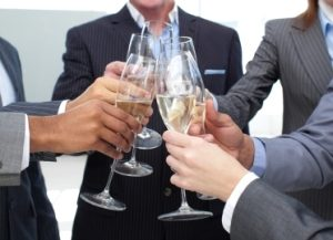 Close-up of business team toasting with Champagne in the office